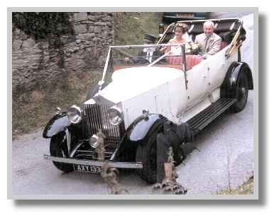 This is what the wedding guests missed - they were waiting in the church! The bride arrives in vintage Rolls-Royce - August 2000 photo: R.J.Tarr